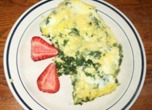 Eggs Florentine and two strawberries, photo by Jim A.