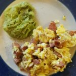 Basic low-carb breakfast: eggs, sausage and guacamole